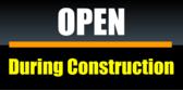 open during construction black yellow bar